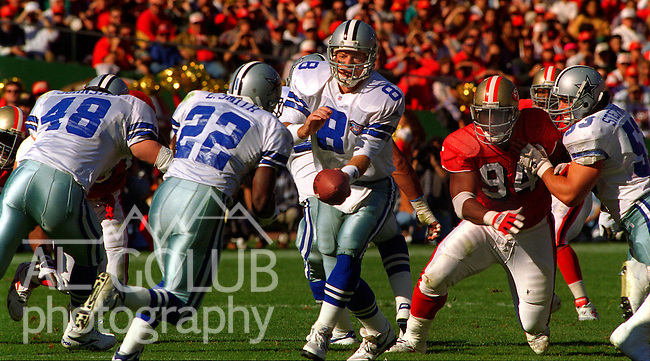 San Francisco 49ers vs. Dallas Cowboys at Candlestick Park Sunday, November 13, 1994.  49ers beat Cowboys 21-14.  Dallas Cowboys quarterback Troy Aikman (8) hands off to running back Emmitt Smith (22).