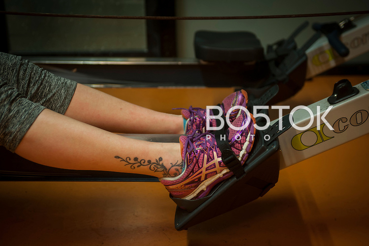 The legs of a female rower on San Juan rower Club on a workout session in the club's gym. Pasaia (Basque Country). January 11, 2017. (Gari Garaialde / BostokPhoto)