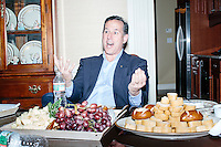 Former Pennsylvania senator and Republican presidential candidate Rick Santorum talks with guests at a party at the home of Carem Bennett in Bedford, New Hampshire. There were eleven people at the gathering, including Bennett, her husband, and their two children. The group chatted about the campaign process and Santorum's position on domestic and international issues.