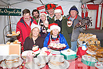 Getting ready for the Christmas farmers market in Listowel in front are Pauline Finucane and Linda Baker. at Back from left John Dowling, Eoghan Molloy, Joanna Watkins, Steve Baker, Bob Summerhayes and Denis Brosnan.