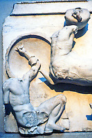 Greek Arts:  The Parthenon--Metopes, a Centaur bringing a water jug down on a Lapith's head. The heads of these figures were removed by a Venetian Captain in 1688 and are now in Copenhagen.