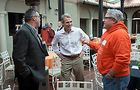 From left, head football coach Rob Cushman, Jeffrey B. Goldstein '86 and John Castner '81.<br /> Occidental College alumni, staff and other members of the Oxy community gather in support of the football program, March 10, 2018 on Branca Patio.<br /> In January 2018 a 16-member task force of trustees, faculty, students, staff and alumni met to determine the fate of the football program in the wake of the premature end of the 2017 season. The College is moving full speed ahead with preparations for the 2018 season, led by the Football Action Team.<br /> (Photo by Marc Campos, Occidental College Photographer)