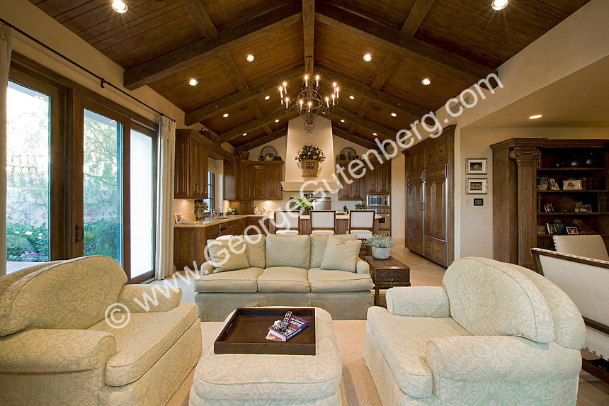 Mediterranean Style Family Room Featuring Wood Beamed Cielings Elegant Furnishings And Warm Colors
