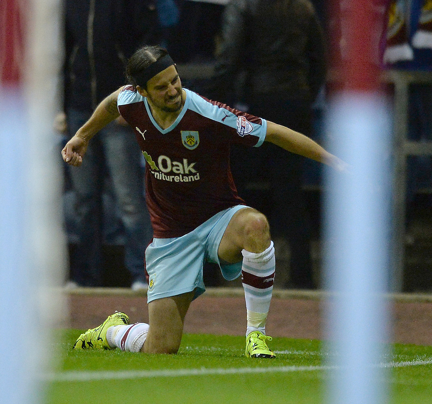 Burnley's George Boyd celebrates scoring his team's second goal<br /> <br /> Photographer Dave Howarth/CameraSport<br /> <br /> Football - The Football League Sky Bet Championship - Burnley v Milton Keynes Dons - Tuesday 15th September 2015 - Turf Moor - Burnley<br /> <br /> &copy; CameraSport - 43 Linden Ave. Countesthorpe. Leicester. England. LE8 5PG - Tel: +44 (0) 116 277 4147 - admin@camerasport.com - www.camerasport.com