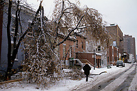 January 1998 - Montreal (Qc) CANADA - Ice storm in Montreal.<br /> <br /> The North American Ice Storm of 1998 (also known as Great Ice Storm of 1998 and Great Ice Storm '98) was a massive combination of five smaller successive ice storms which combined to strike a relatively narrow swath of land from eastern Ontario to southern Quebec to Nova Scotia in Canada, and bordering areas from northern New York to central Maine in the United States, in January 1998. It caused massive damage to trees and electrical infrastructure all over the area, leading to widespread long-term power outages. Millions were left in the dark for periods varying from days to weeks, leading to more than 30 fatalities, a shut down of activities in large cities like Montreal and Ottawa, and an unprecedented effort in reconstruction of the power grid. The ice storm led to the largest deployment of Canadian Military personnel since the Korean War, with over 15,000 Canadian Forces personnel deployed in Ontario, Quebec and New Brunswick at the height of the crisis.January 1998 - Montreal (Qc) CANADA - Ice storm in Montreal.<br /> <br /> The North American Ice Storm of 1998 (also known as Great Ice Storm of 1998 and Great Ice Storm '98) was a massive combination of five smaller successive ice storms which combined to strike a relatively narrow swath of land from eastern Ontario to southern Quebec to Nova Scotia in Canada, and bordering areas from northern New York to central Maine in the United States, in January 1998. It caused massive damage to trees and electrical infrastructure all over the area, leading to widespread long-term power outages. Millions were left in the dark for periods varying from days to weeks, leading to more than 30 fatalities, a shut down of activities in large cities like Montreal and Ottawa, and an unprecedented effort in reconstruction of the power grid. The ice storm led to the largest deployment of Canadian Military personnel since the Korean War, with over 15,000 Canadi