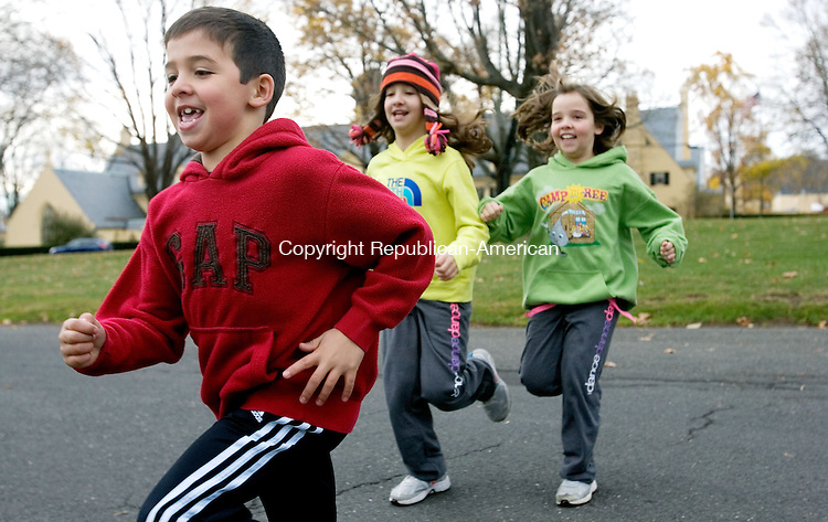 MIDDLEBURY CT. 09 November 2013-110913SV13-From left, Ben Goncalves, 7, of Middlebury gets ready to run with his sisters, Sara Goncalves, 10, and Kate Goncalves, 9, during the at the Pilgrim's Pace 5K and fun run, sponsored by the Middlebury Congregational Church, in Middlebury Saturday. <br /> Steven Valenti Republican-American