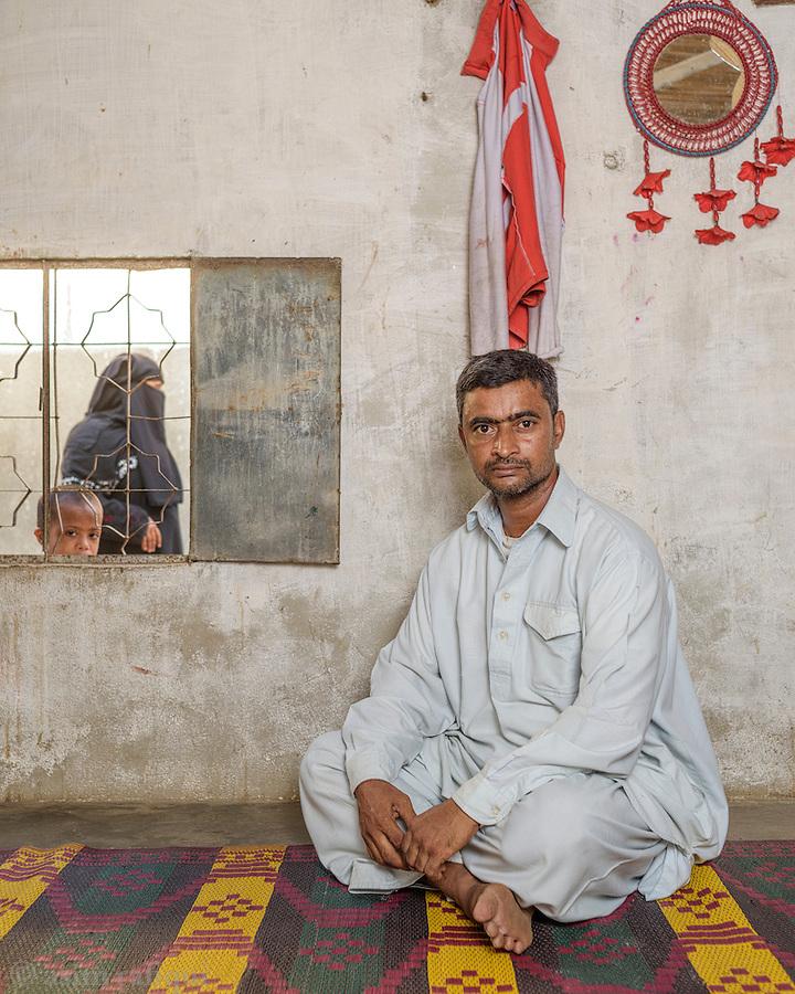 Hussain Ahmed, a garment factory worker from Karachi.
