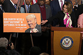 United States House Minority Leader Nancy Pelosi (Democrat of California) points to a tweet by US President Donald J. Trump during a press conference held by US House Democrats at the United States Capitol on the first morning of a government shutdown as congress looks to end the political deadlock and fund the government on January 20th, 2018 in Washington, D.C. <br /> Credit: Alex Edelman / CNP