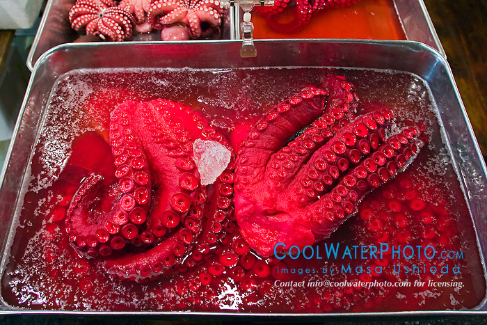 pickled and colored octopus tentacles for sale at wholesale shop, Tsukiji Fish Market or Tokyo Metropolitan Central Wholesale Market, the world's largest fish market, hadling over 2,500 tons and over 400 different kind of fresh sea food per day