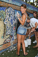 Maria Menounos  celebrates the Bing summer of Doing with dosomething.org by volunteering and restoring CITYarts Mosaic Peace Wall. Harlem, New York. July 10, 2012 © Diego Corredor/MediaPunch Inc.