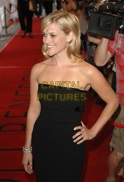 "REESE WITHERSPOON.""Rendition"" Premiere during the 32nd Annual Toronto International Film Festival held at Roy Thompson Hall, Toronto, Ontario, Canada, 07 September 2007. .half length strapless black dress buckles hand on hip.CAP/TL.©Tony Lee/Capital Pictures."