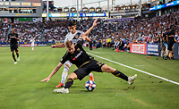 CARSON, CA - JULY 19: Walker Zimmerman #25 of Los Angeles Football Club and Uriel Antuna #18 of the Los Angeles Galaxy get after a ball in the corner during a game between Los Angeles FC and Los Angeles Galaxy at Dignity Health Sports Complex on July 19, 2019 in Carson, California.