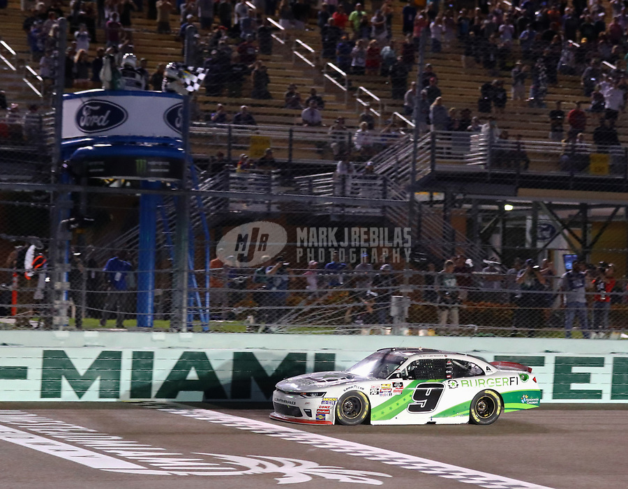 Nov 17, 2018; Homestead, FL, USA; NASCAR Xfinity Series driver Tyler Reddick takes the checkered flag to win the 2018 championship and the Ford EcoBoost 300 at Homestead-Miami Speedway. Mandatory Credit: Mark J. Rebilas-USA TODAY Sports