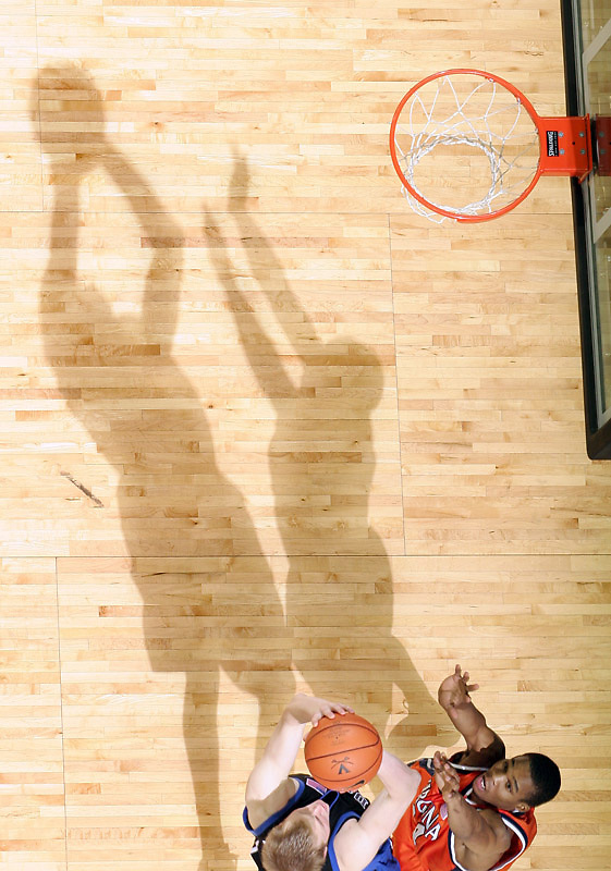 Shadows play larger than life as Virginia's Sean Singletary defends Duke's Martynas Pocius during the game March 5, 2008.