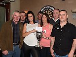 Sarah Thompson and Michelle Bradley present the Karen Thompson Memorial cup to league winners Watters of Collon darts team at the Drogheda Darts League Presentation night in the Punt. Photo:Colin Bell/pressphotos.ie