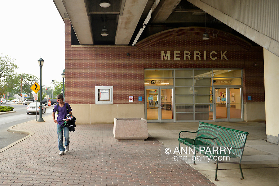 During evening rush hour, passengers are on elevated platform of Merrick train station of Babylon branch, after MTA Metropolitan Transit Authority and Long Island Rail Road union talks deadlock, with potential LIRR strike looming just days ahead.