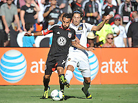 Dwayne De Rosario (7) of D.C. United goes against Omar Gonzalez (4) of the Los Angeles Galaxy.  D.C. United tied the Los Angeles Galaxy 2-2, at RFK Stadium, Saturday September 14 , 2013.