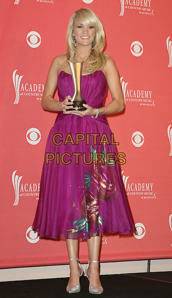 CARRIE UNDERWOOD.The 43rd Annual Academy of Country Music Awards (ACM) held at MGM Grand Garden Arena, Las Vegas, Nevada, USA, 18 May 2008..full length pink purple dress floral print strapless trophy award.CAP/ADM/MJT.©MJT/Admedia/Capital Pictures