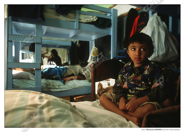 Young Pakistani at Vive La Casa refugee shelter; Buffalo, New York, March 2003