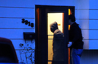 A person is allowed to re-enter the residence 3918 E 11th Ave after being detained while a search was conducted at about 6am on Thursday March 13, 2014.