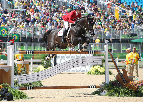 14.08.2016. Rio de Janeiro, Brazil. Tiffany Foster of Canada on horse Triple X III clears an obstacle during the Jumping Team 1st Qualifier of the Equestrian competition at the Olympic Equestrian Centre during the Rio 2016 Olympic Games in Rio de Janeiro, Brazil, 14 August 2016.