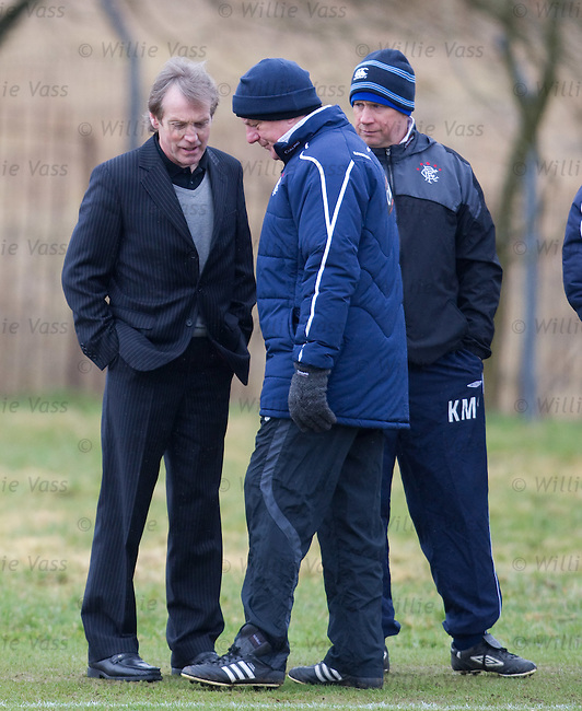 Chief scout Ewan Chester arrives to update Walter Smith during the training session