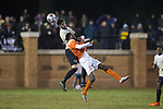 Sam Raben (26) of the Wake Forest Demon Deacons battles for a jump ball with Kimarni Smith (17) of the Clemson Tigers during second half action at Spry Soccer Stadium on November 8, 2017 in Winston-Salem, North Carolina.  The Demon Deacons defeated the Tigers 2-1.  (Brian Westerholt/Sports On Film)