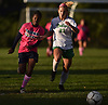 Alyssa Hillian #1 of Baldwin, left, and Allison Kiernan #23 of Farmingdale chase after a loose ball during a Nassau County Conference AA-1 varsity girls soccer game at Baldwin High School on Wednesday, Oct. 17, 2018. Hillian netted the match's opening goal for Baldwin in the 17th minute while Kiernan scored to break a 1-1 tie late in the first half. Farmingdale went on to win by a score of 3-1.