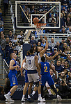 Nevada forward Trey Porter (15) reaches for a rebound against South Dakota State in the second half of an NCAA college basketball game in Reno, Nev., Saturday, Dec. 15, 2018. (AP Photo/Tom R. Smedes)