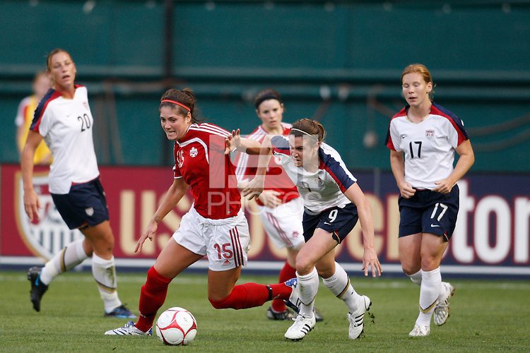 Canada forward Kara Lang (15) and United States midfielder Heather O'Reilly (9) battle for the ball. The women's national team of the United States defeated Canada 6-0 during an international friendly at Robert F. Kennedy Memorial Stadium in Washington, D. C., on May 10, 2008.