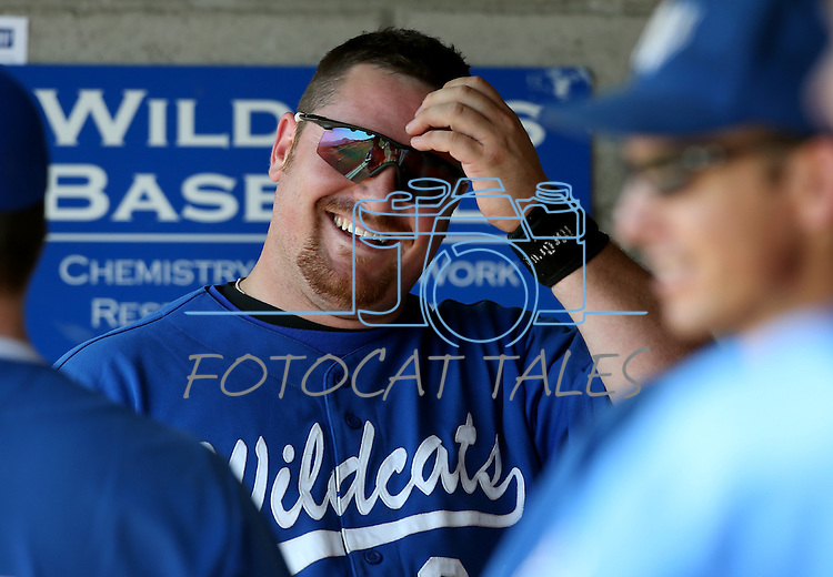 Former Wildcat Tyson Jaquez jokes with teammates in the dugout during the alumni game at Western Nevada College in Carson City, Nev., on Saturday, Sept. 7, 2013.  <br /> Photo by Cathleen Allison