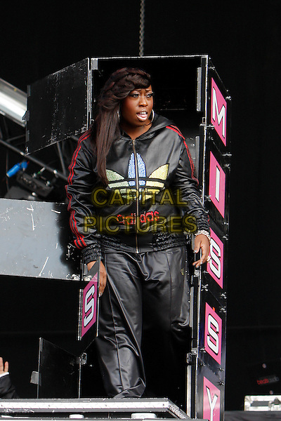 "MISSY ""Misdemeanor"" ELLIOTT (Melissa Arnette Elliott).Performing live at Wireless Festival in Hyde Park, London, England, UK, .July 3rd 2010..concert music gig live on stage half length 3/4 black shiny adidas tracksuit zip up top trousers bottoms sportswear red stripes .CAP/MAR.© Martin Harris/Capital Pictures."