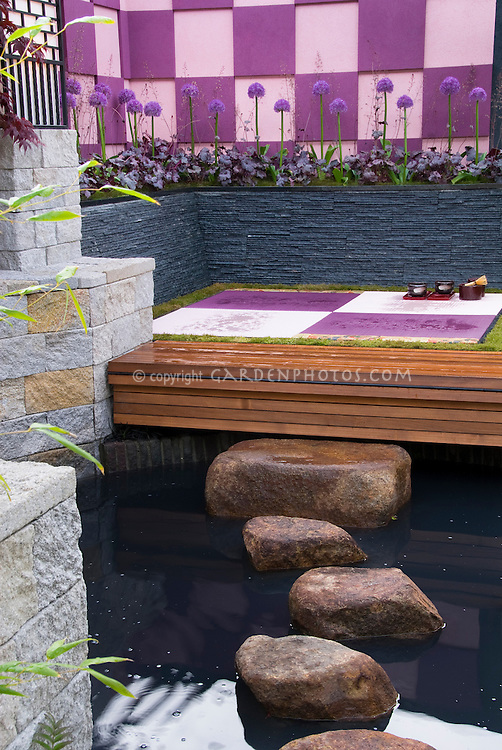 Meditation zen garden : Creating an outdoor room with sense of enclosure with patterned wall, Zen feel post and deck, trellis covering, Japanese maple tree Acer palmatum, raised beds with purple alliums flowers and heuchera perennials for a color coordinated, harmonious backyard landscaping designed by Takumi Awai