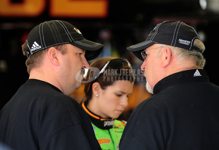 Feb. 26, 2010; Las Vegas, NV, USA; NASCAR Nationwide Series crew chief Tony Eury Jr (left) and Tony Eury Sr talk as Danica Patrick listens on during practice for the Sams Town 300 at Las Vegas Motor Speedway. Mandatory Credit: Mark J. Rebilas-