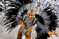 A samba school dancer performs during the Carnival Access Group parade at the Sambadrome in Rio de Janeiro, Brazil, 19 February 2012. The Carnival in Rio de Janeiro, considered the biggest carnival in the world, is a colorful, four day celebration, taking place every year forty days before Easter. The Samba school parades, featuring thousands of dancers, imaginative costumes and elaborate floats, are held on the Sambadrome, a purpose-built stadium in downtown Rio. According to costumes, flow, theme, band music quality and performance, a single school is declared the winner of the competition.