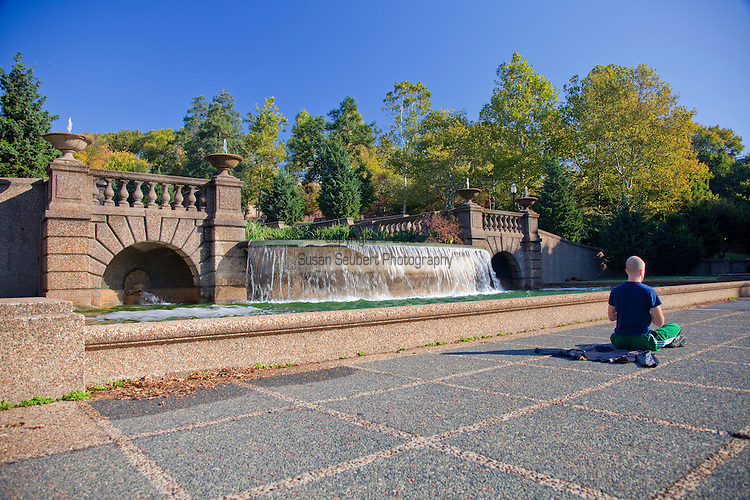 Meridian Hill Park, also known unofficially as Malcolm X Park, is located in the Washington, D.C. neighborhood of Columbia Heights in the United States. The 12 acres of landscaped grounds are maintained by the National Park Service as part of Rock Creek Park, but are not contiguous with the main part of that park. Meridian Hill Park is bordered by 15th, 16th, W, and Euclid Streets NW