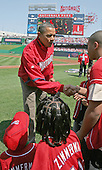 United States President Barack Obama is congratulated by kids on the sidelines at Nationals Stadium moments after he threw out the first pitch at the Washingon Nationals home opener, Washington, DC, Monday, April 5, 2010, to mark the 100th anniversary of the presidential tradition. William Howard Taft was the first president to do so in 1910..Credit: Martin H. Simon / Pool via CNP