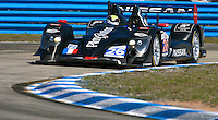 The #26 Nissan Oreca 03 of  Franck Mailleux, Lucas Ordonez and Soheil Ayari races through a turn during qualifying for the 12 Hours of Sebring, Sebring International Raceway, Sebring, FL, March 18, 2011.  (Photo by Brian Cleary/www.bcpix.com)