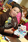 James Ettie at the Card Making Workshop in The Library...Photo NEWSFILE/Jenny Matthews.(Photo credit should read Jenny Matthews/NEWSFILE)....This Picture has been sent you under the condtions enclosed by:.Newsfile Ltd..The Studio,.Millmount Abbey,.Drogheda,.Co Meath..Ireland..Tel: +353(0)41-9871240.Fax: +353(0)41-9871260.GSM: +353(0)86-2500958.email: pictures@newsfile.ie.www.newsfile.ie.FTP: 193.120.102.198.