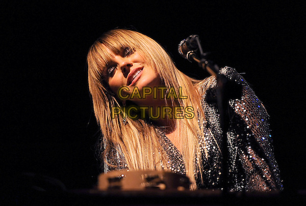GRACE POTTER of Grace Potter and The Nocturnals .performs live at The El Rey Theatre in Los Angeles, California, USA, .February 4th 2011..music concert gig on stage  half length fringe microphone eyes shut closed                                                                     .CAP/RKE/DVS.©DVS/RockinExposures/Capital Pictures.