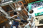 Images from the first half of action between Tulane and UConn, as the Huskies went on to down the Green Wave, 67-57.