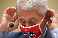 Anthony Fauci, director of the National Institute of Allergy and Infectious Diseases, wears a Washington Nationals protective mask during a House Select Subcommittee on the Coronavirus Crisis hearing in Washington, D.C., U.S., on Friday, July 31, 2020. Trump administration officials are set to defend the federal government's response to the coronavirus crisis at the hearing hosted by a House panel calling for a national plan to contain the virus.<br /> Credit: Erin Scott / Pool via CNP /MediaPunch