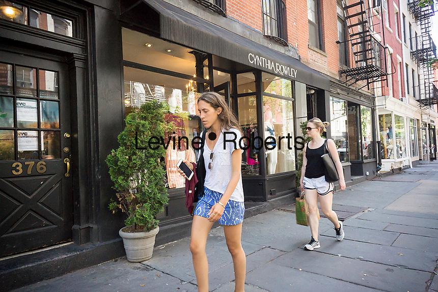 Shopping on trendy Bleecker Street in New York on Monday, June 6, 2016. (© Richard B. Levine)