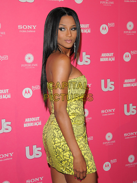 CIARA (CIARA PRINCESS HARRIS).The Annual US Weekly Hot Hollywood Style Party at Drai's in Hollywood, California, USA..April 22nd, 2010.half length yellow black strapless mini dress side looking over shoulder pattern print.CAP/RKE/DVS.©DVS/RockinExposures/Capital Pictures.