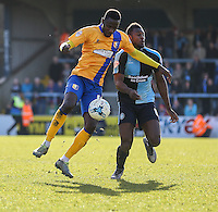 Mani Dieseruvwe of Mansfield Town (left) and Aaron Pierre of Wycombe Wanderers (right) during the Sky Bet League 2 match between Wycombe Wanderers and Mansfield Town at Adams Park, High Wycombe, England on 25 March 2016. Photo by David Horn.