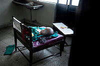 Victoria lies on a chair in the back room of the public maternity hospital Paropakar in Kathmandu. This photograph was published in Danish newspaper Berlingske in September 2010 and caught the attention of Cecilie Hansen who later travelled to Kathmandu to look after Victoria. Victoria was born with hydrocephalus - water on the brain. She died on November 19 2010 from heart failure.
