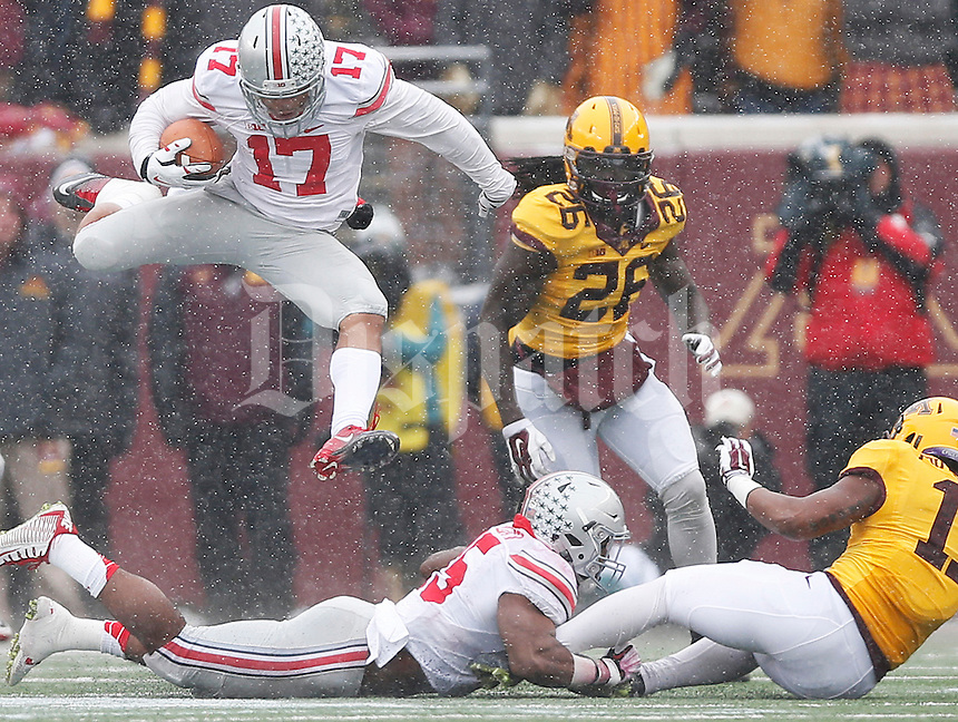 Ohio State Buckeyes running back Jalin Marshall (17) leaps through the air as he runs the ball in the second quarter of the college football game between the Ohio State Buckeyes and the Minnesota Golden Gophers at TCF Bank Stadium in Minneapolis, Saturday morning, November 15, 2014. As of half time the Ohio State Buckeyes led the Minnesota Golden Gophers 17 - 14. (The Columbus Dispatch / Eamon Queeney)
