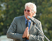 Washington, DC - October 17, 2007 -- Activist and actor Richard Gere moderates the program where The 14th Dalai Lama, Tenzin Gyatso, makes a speech on the West Lawn of the United States Capitol in Washington, D.C. on Wednesday, October 17, 2007.  Earlier, inside the Rotunda of The Capitol the Dalai Lama accepted the Congressional Gold Medal, the nation's highest and most distinguished civilian award..Credit: Ron Sachs/CNP