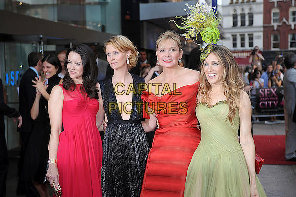 "KRISTIN DAVIS, CYNTHIA NXON, KIM CATTRALL & SARAH JESSICA PARKER.attending the World Premiere of ""Sex and the City: The Movie"", Odeon Leicester Square, London, England, 12th May 2008..half length red vivienne westwood dress off the shoulder strapless green McQueen hat Philip Treacy butterflies Guy Laroche Calvin Klein black.CAP/BEL.©Tom Belcher/Capital Pictures"