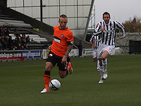 Johnny Russell pursued by Lee Mair in the St Mirren v Dundee United Clydesdale Bank Scottish Premier League match played at St Mirren Park, Paisley on 27.10.12.